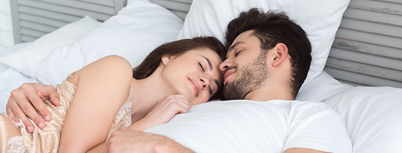 Man and woman sleeping deeply