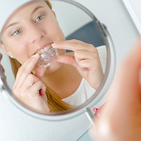 Woman placing oral appliance