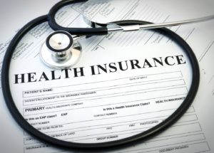 Health insurance form for sleep apnea treatment beneath stethoscope